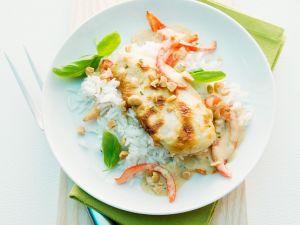 Hähnchen mit Erdnusssauce und Reis Rezept