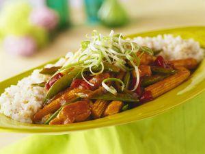 Hähnchen mit Gemüse und Reis Rezept