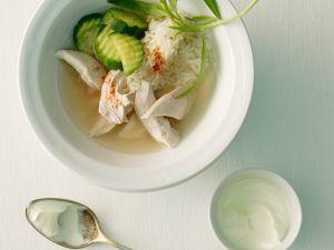 Hähnchenfleisch mit Zucchini und Reisbeilage Rezept