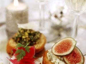 Häppchen mit Jakobsmuschel, Käse und Feige Rezept