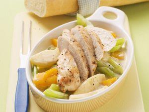 Hühnchen auf Rahmgemüse Rezept