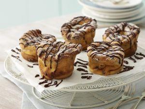 Käsekuchen-Muffins mit Schokostreifen Rezept