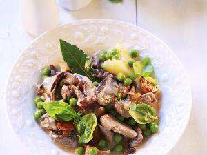 Kalb mit Erbsen, Champinons und Sahnesauce Rezept