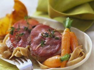 Kalbsschnitzel mit Kräutern und Schinken Rezept