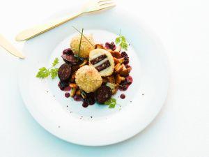 Kartoffel-Blutwurstklöße auf Pfifferlingen Rezept