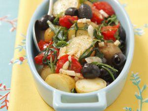 Kartoffelgratin mit Cherrytomaten, Oliven und Rucola Rezept