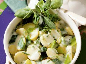Kartoffeln und Lauch und Béchamelsoße Rezept