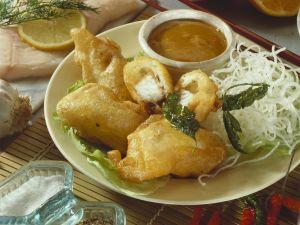Knusper-Fisch mit frittierten Glasnudeln Rezept