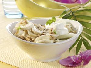 Kokos-Müsli mit Banane und Melone Rezept