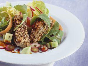 Kürbiskern-Fischstäbchen mit Salat Rezept