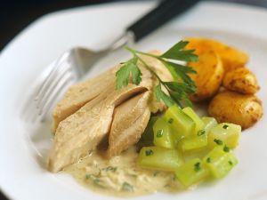 Lachs mit Weinsauce und Gemüse Rezept