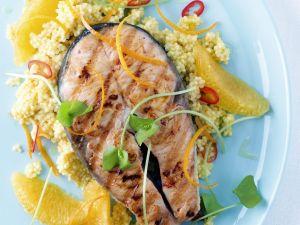 Lachskotelett in Marinade mit Goldhirse und Orange Rezept