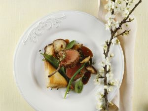 Lammkarree und Teigtaschen mit Shiitake und Spinat gefüllt Rezept