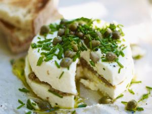 Lauwarmer Oliven-Ziegenkäse Rezept
