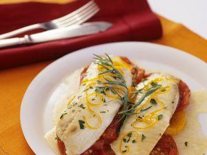 Loup de mer auf Tomaten im Ofen gebacken Rezept