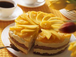 Mandelkuchen mit fruchtiger Cremefüllung Rezept