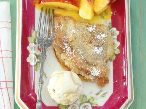 Marzipan-Crêpes mit Orangenbutter und Nektarinenspalten Rezept