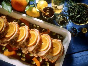 Mediterraner Schweinebraten mit Oliven und Orangen Rezept