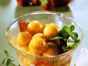Melone in Sirup mit Sabayon Rezept