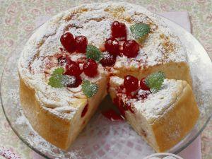 Milchreiskuchen mit Amarena-Kirschen Rezept