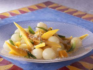 Obstsalat mit Mango, Melone und Kräutern Rezept