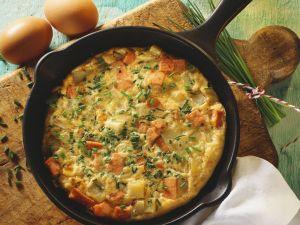 Omelette mit Kartoffeln und Wurst Rezept
