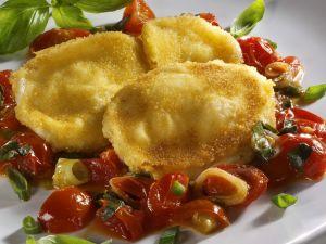 Panierter Mozzarella mit Tomaten Rezept