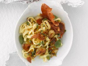 Pasta mit Parmaschinken und gebratenem Knoblauch Rezept