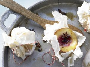 Pfirsiche in Pergament Rezept