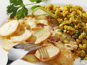 Risotto von roten Linsen mit Bratkartoffeln Rezept