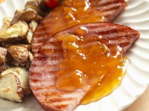 Schinken vom Grill mit Orangensoße und Kartoffeln Rezept