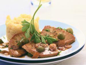 Schnitzel mit Olivensauce Rezept