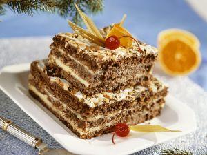 Schoko-Nuss-Torte mit cremiger Vanillefüllung Rezept