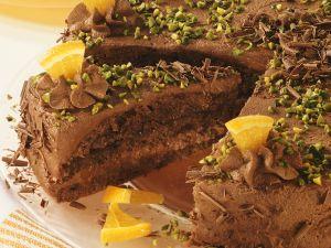 Schokoladentorte mit Pistazien und Orangenstückchen Rezept