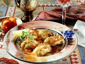 Seeteufel-Schnitzel mit Tomaten Rezept