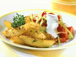 Sesam-Kartoffeln mit Paprikagemüse Rezept