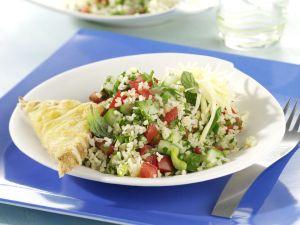 Taboulé-Salat mit Käse-Toastecken Rezept