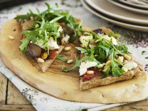 Vollkorn-Pizza mit Ricotta und Rucola Rezept