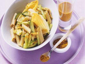 Vollkornnudeln mit Curry, Zucchini und Sanddorn Rezept