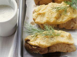 Waller mit Kartoffelhaube und Biersoße Rezept