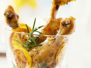 Würzige Hähnchenkeulen mit Zitrone und Rosmarin Rezept