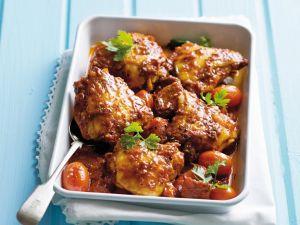 Würziges Hähnchenteile mit Tomaten aus dem Ofen Rezept