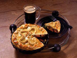 Wurst-Pie mit Sellerie und Champignon Rezept