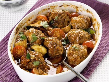 Gebackene Lammfleischbällchen mit Tomaten und Zucchini