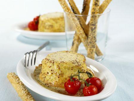 Käsesoufflee mit Soße aus süßem Senf dazu Kirschtomaten und Sesamsticks