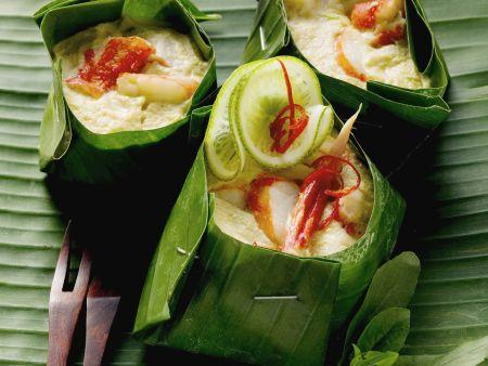 Krabbenfleisch mit Kokossoße im Bananenblatt