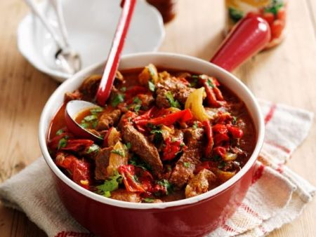 paprika beef in a red bowl