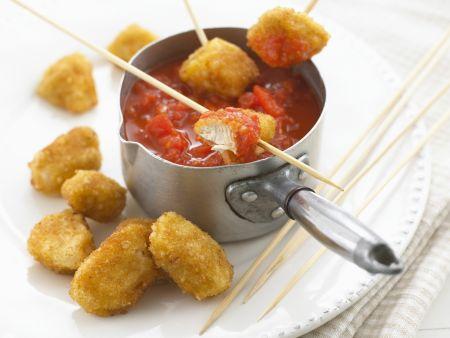Panierte Hähnchenstücke mit Tomatendip