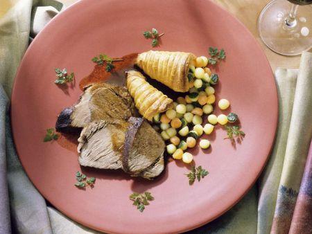 Schweinebraten mit Gemüsebällchen