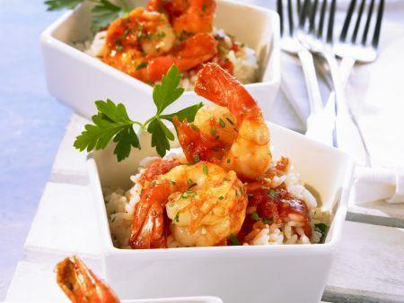 Shrimps mit Cognac-Tomaten-Soße und Reis